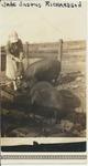Jane Justus Richardson feeding the hogs